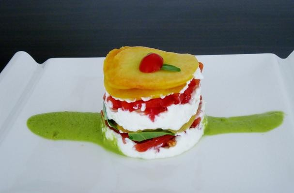 Peaches, tomatoes, and goat cheese layer cake with a peach-basil sauce